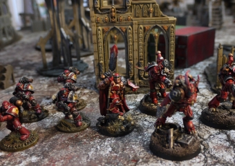 The Dark Apostle accompanied by his possessed retinue.
